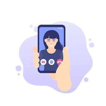 Videochiamata, smart phone in mano icona