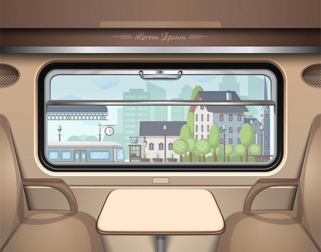 Vista della stazione ferroviaria dal finestrino del treno.