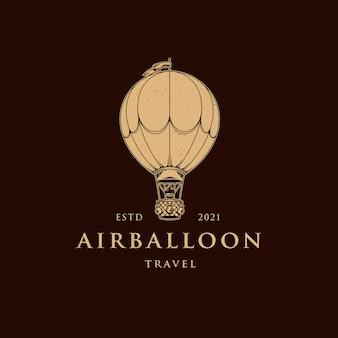 Modello di logo dell'aerostato di aria dell'annata isolato su colore marrone