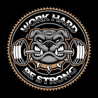 Distintivo dell'annata del cane, mascotte di bodybuilding su sfondo scuro.