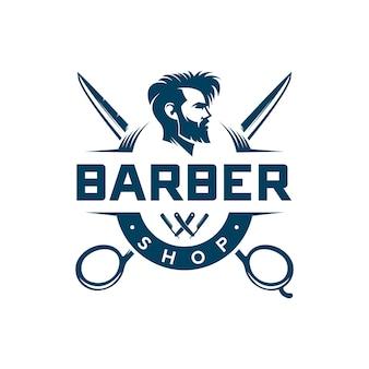 Distintivo ed emblema del negozio di barbiere dell'annata isolato su bianco
