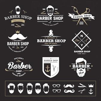 Logo del negozio del barbiere dell'annata e elementi di vettore