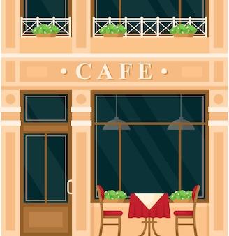 Costruzione della casa del caffè dell'annata. via della città europea del fumetto con la costruzione di esterno verde