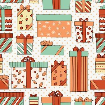 Reticolo senza giunte dell'annata di natale o compleanno con scatole regalo. può essere utilizzato per lo sfondo del desktop o la cornice per appendere a parete o poster, trame di superficie, sfondi di pagine web e altro ancora. Vettore Premium
