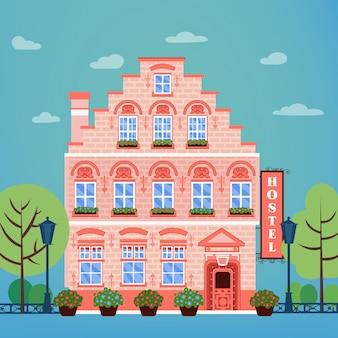 Vintage city hostel europeo. facciata della costruzione dell'hotel di industria di viaggio