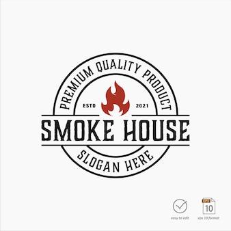 Design logo grill vintage con elemento fiamma