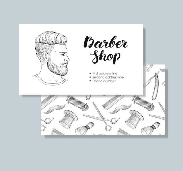 Biglietti da visita di barber shop disegnati a mano vintage.