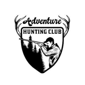 Cacciatore vintage con distintivo dell'emblema di caccia e avventura con la pistola