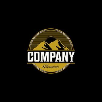 Illustrazione all'aperto di logo della società della montagna d'annata nel fondo scuro