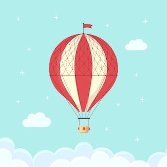 Aerostato di aria calda retrò vintage con cesto in cielo