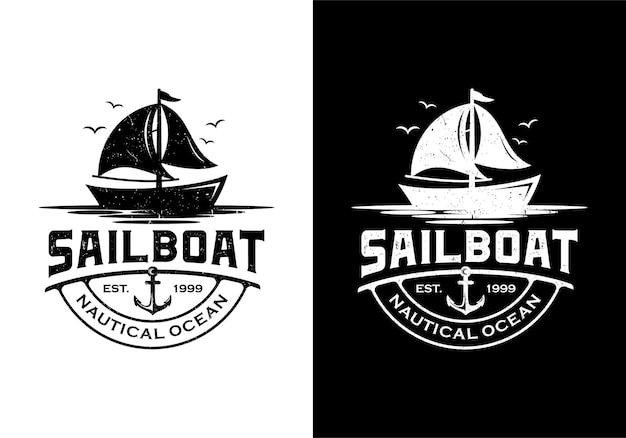 Logo marino vintage retrò barca a vela