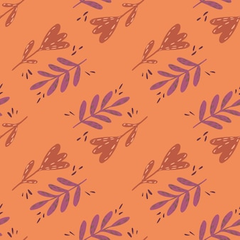 Vintage seamless pattern con disegnati a mano foglie rami ed elementi floreali su sfondo arancione.