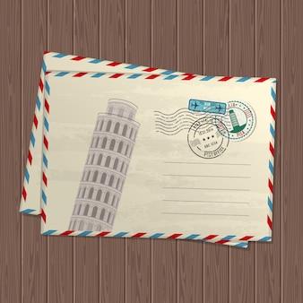 Lettere di stile vintage con torre pendente di pisa, marchi e francobolli d'italia e luogo per il testo su struttura in legno