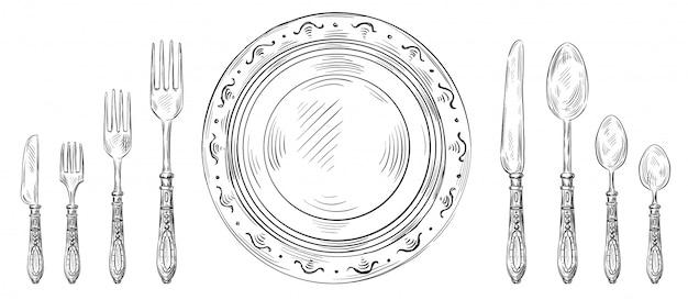 Impostazione del tavolo vintage. coltello da pranzo disegnato a mano, piatto da schizzo e posate per incisione. insieme dell'illustrazione della forchetta e del cucchiaio del ristorante