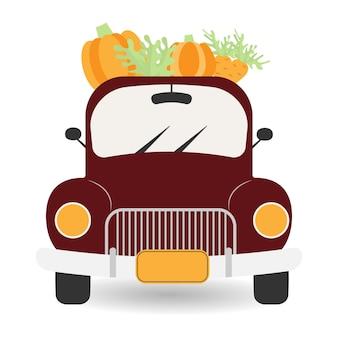 Macchina rossa del raccolto del camion dell'annata con le zucchecamion pick-up con il raccolto