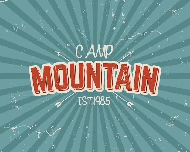 Design vintage tipografia con frecce e testo, campo di montagna