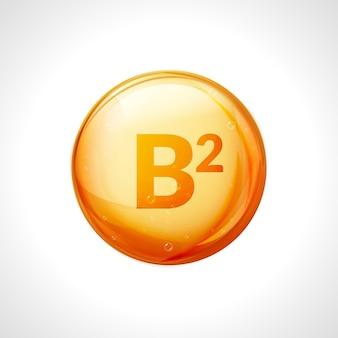 Essenza d'oro di vitamina b2. trattamento vitaminico con pillola a goccia di riboflavina. medicina naturale dorata isolata.