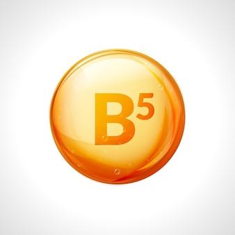 Pillola di vitamina b5. cura nutrizionale dell'acido pantotenico. essenza goccia d'oro. simbolo dorato isolato della vitamina b5.