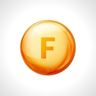 Vitamina f oro. essenza di pillola di goccia di vitamina acido linoleico. il trattamento integra la salute e la nutrizione.