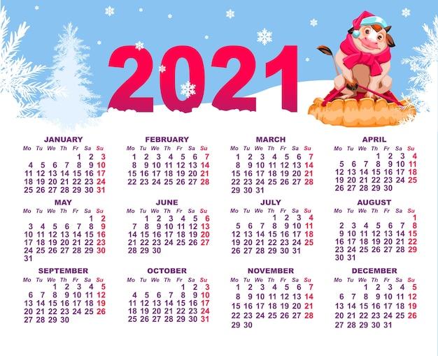 Calendario da parete con mucca su slitta e bosco invernale con neve