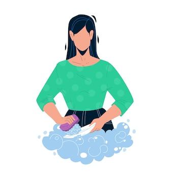 Lavare i piatti con sapone nel lavello da cucina vettore. giovane donna che lava i piatti con detersivo per bolle e spugna dopo cena. piatti di lavaggio della ragazza del carattere, illustrazione piana del fumetto di compiti a casa