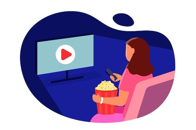 Guarda il film ragazza con popcorn seduto davanti allo schermo tv e cambia i canali tv vector flat