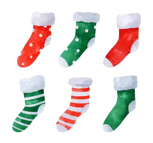 Set acquerello di simpatici calzini natalizi isolati su bianco