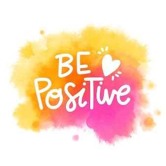 Macchia dell'acquerello con messaggio di lettere positive