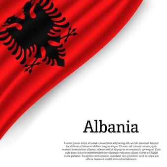 Sventolando la bandiera dell'albania su bianco