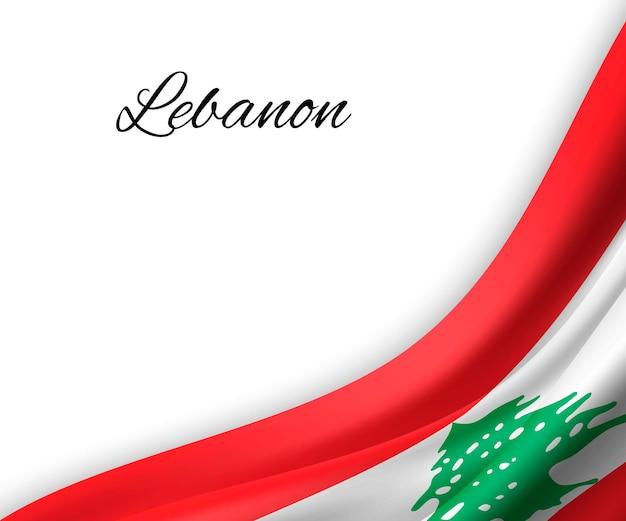Sventolando la bandiera del libano su sfondo bianco.