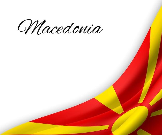 Sventolando la bandiera della macedonia su sfondo bianco.