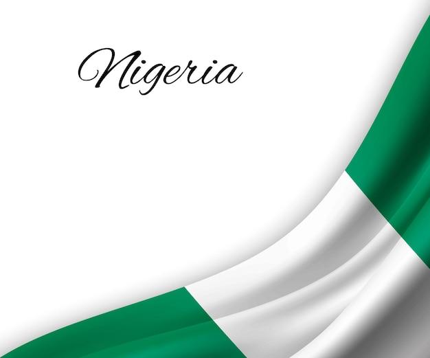 Sventolando la bandiera della nigeria su sfondo bianco.