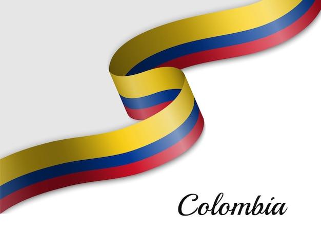 Sventolando la bandiera del nastro della colombia