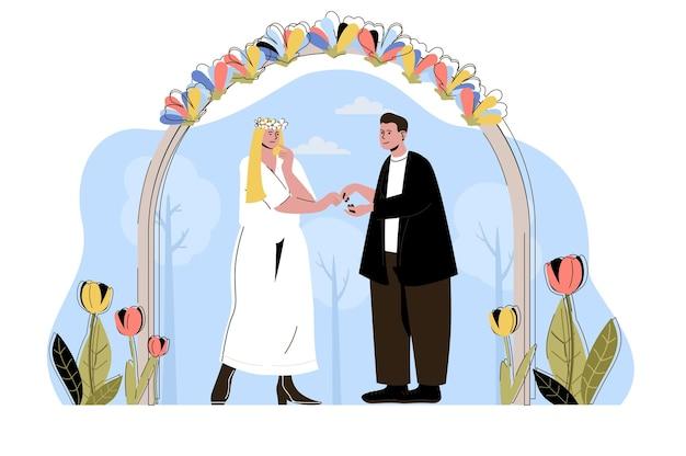 Concetto di cerimonia di matrimonio gli sposi si scambiano gli anelli la coppia si sposa