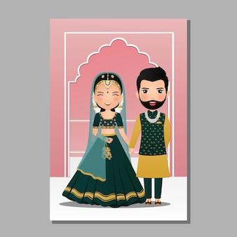 Carta dell'invito di nozze la coppia sveglia dello sposo e della sposa nell'illustrazione indiana tradizionale del personaggio dei cartoni animati del vestito
