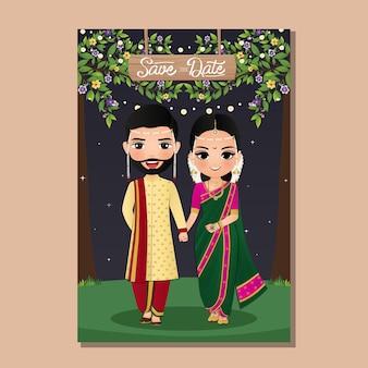 Carta di invito a nozze la coppia carina sposi in abito tradizionale indiano cartone animato Vettore Premium