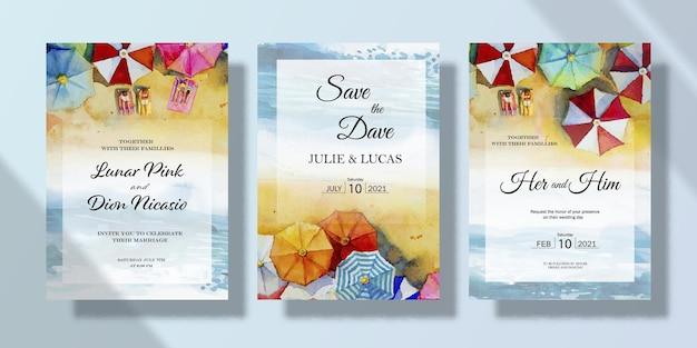 Set di biglietti di invito a nozze con dipinti di paesaggi marini con ombrelli ad acquerello