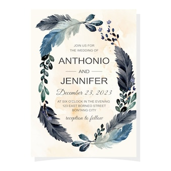 Carta di invito di nozze con piuma e foglie dell'acquerello