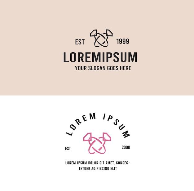 La coppia di fedi nuziali ama il logo vintage
