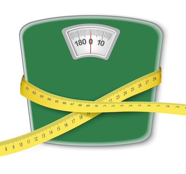 Bilancia pesapersone con metro a nastro. concetto di dieta.