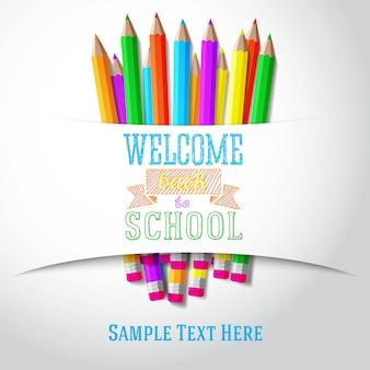 Bentornati a scuola saluto disegnato a mano con matite colorate sotto il nastro di carta. vettore