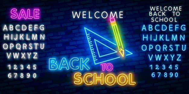 Bentornato a scuola. effetto di stile al neon di alfabeto di carattere tipografia