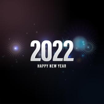 Testo bianco 2022 felice anno nuovo su sfondo nero di fuochi d'artificio.