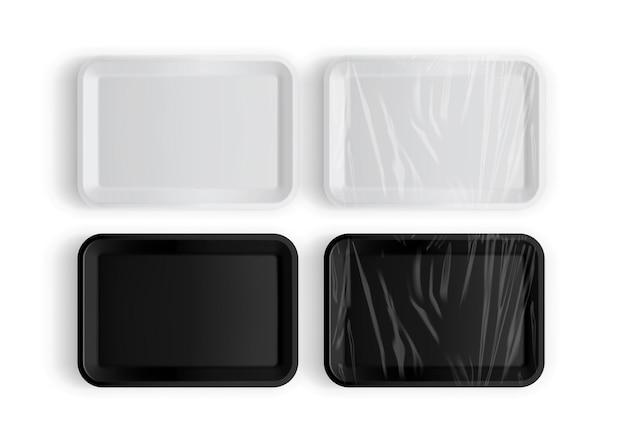 Imballaggio vassoio bianco e nero per alimenti isolati su bianco