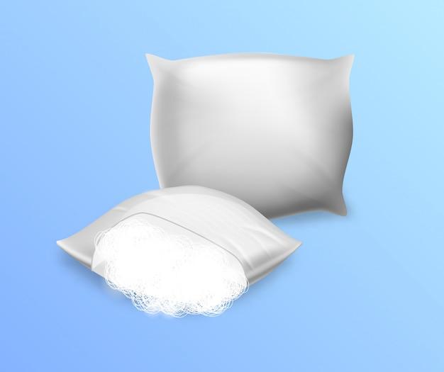 Cuscini in bianco bianchi di sintepon isolati Vettore Premium