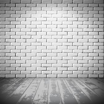 Stanza in mattoni bianchi con pavimento in legno