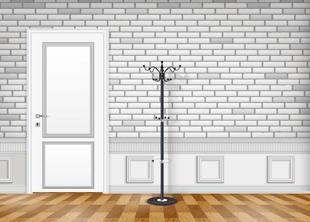 Muro di mattoni bianchi con una porta chiusa e cappello e appendiabiti