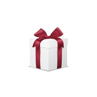 Contenitore di regalo bianco con l'arco rosso del nastro, isolato su bianco