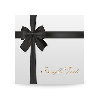 Biglietto di auguri bianco con fiocco nero isolato su bianco