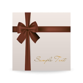 Biglietto di auguri bianco con fiocco marrone isolato su bianco